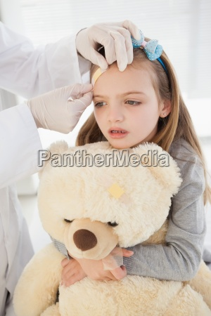 girl getting a bandage on her