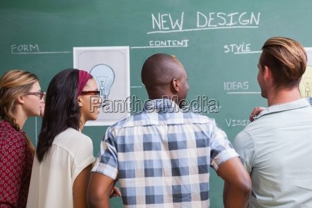 team brainstorming with ideas written on