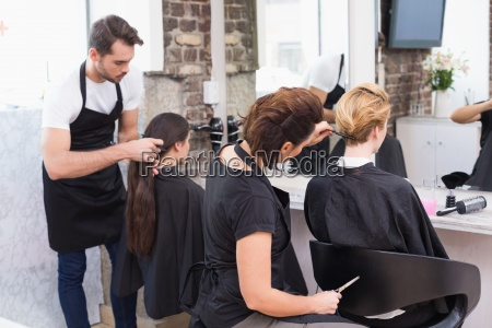 hairdressers working on their clients