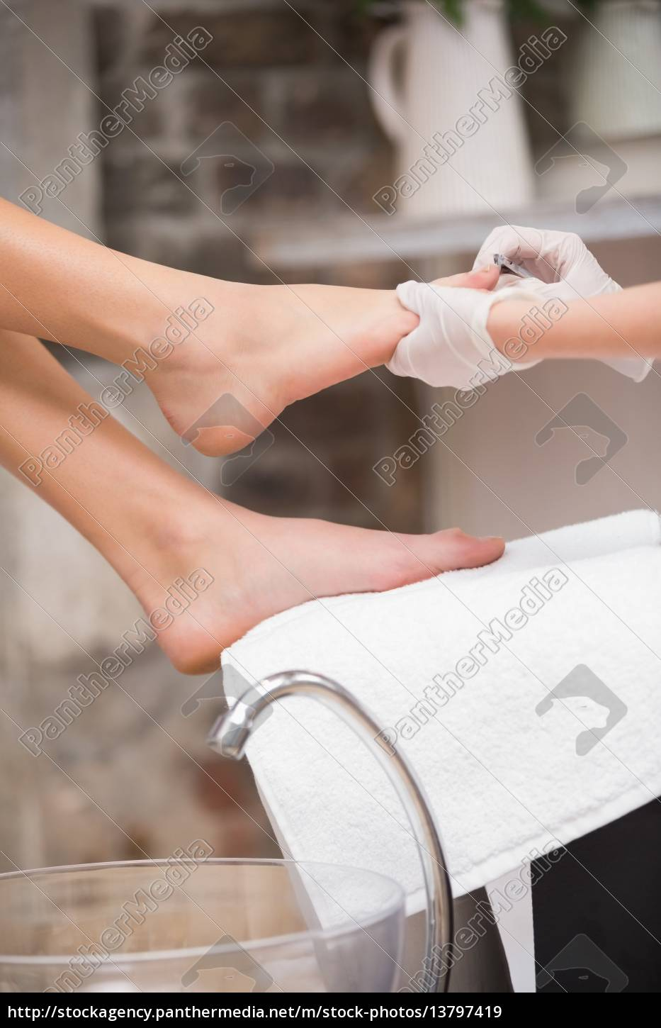 woman, getting, a, pedicure, from, beautician - 13797419