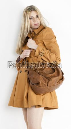 portrait of standing woman wearing brown