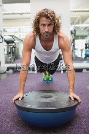 handsome man doing crossfit fitness workout