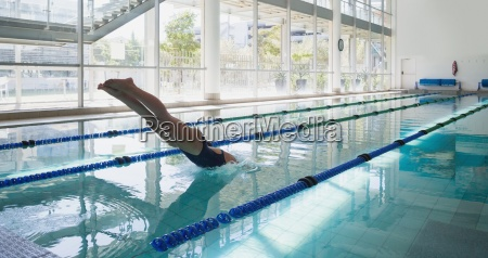 swimmer diving into the pool at