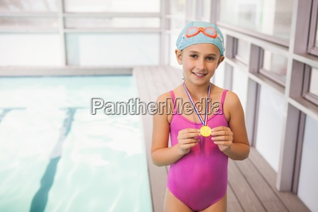cute little girl showing her swimming