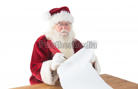 santa writes something with a feather