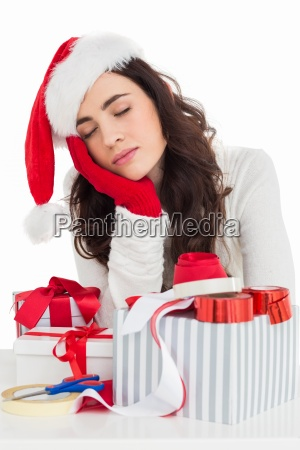 brown hair in santa hat napping
