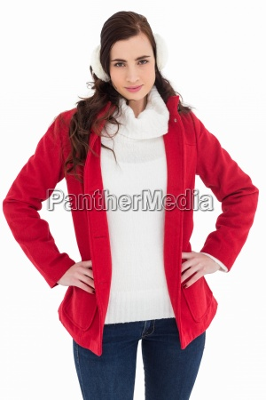 smiling brunette posing with winter wear