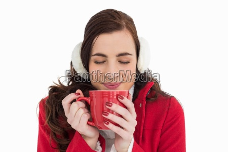 woman in winter clothes enjoying a