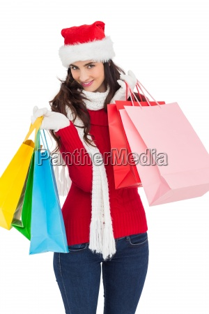 smiling brunette in winter wear holding