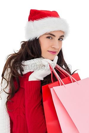 pretty brunette in winter wear holding