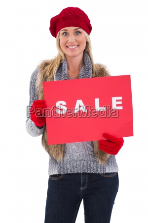 blonde in winter clothes holding sale