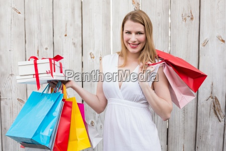 elegant blonde with shopping bags and