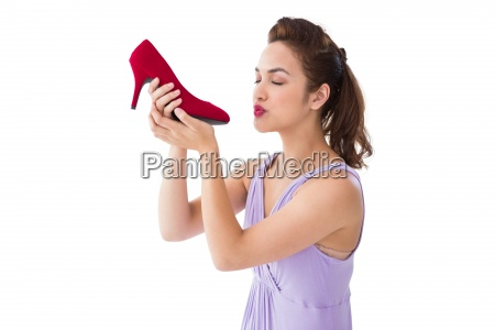 elegant brunette kissing a shoe