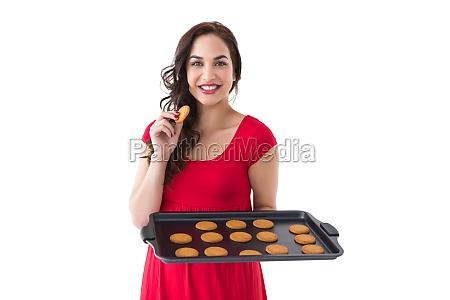 happy brunette eating hot cookies