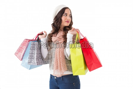 thoughtful brunette with shopping bags