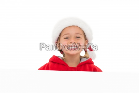 festive little girl showing poster