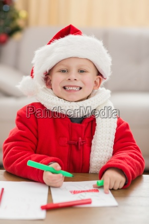 festive little boy drawing pictures