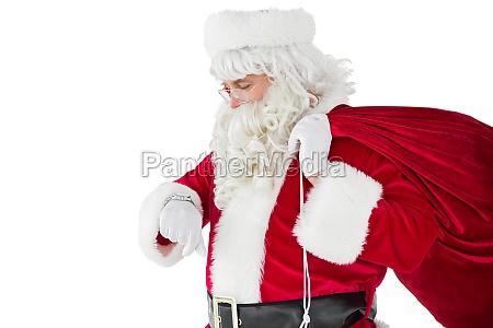 festive santa claus checking time