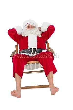 happy santa relaxing on deckchair