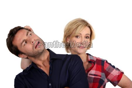 wife pushing husbands head