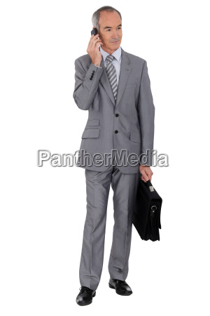 senior man in suit on white