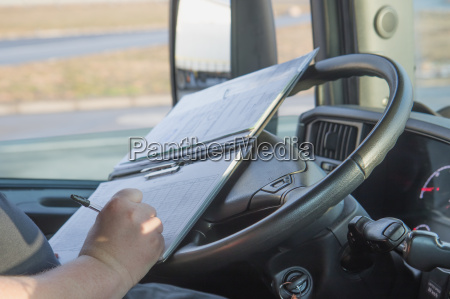 truck driver is writing in the