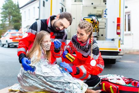 paramedics help injured woman