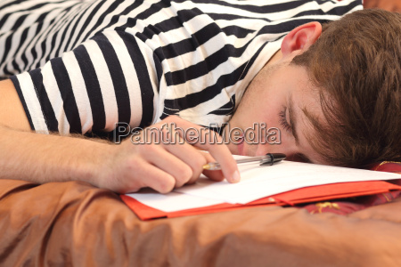 tired student resting in his bedroom
