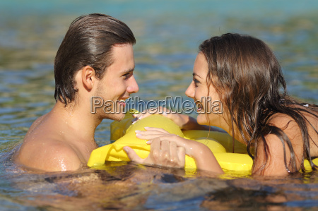 couple in summer vacation bathing on