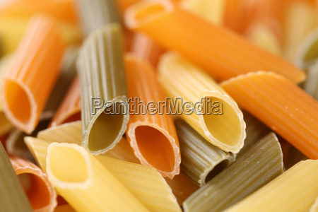 colorful raw penne rigate pasta pasta