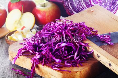 shredded purple cabbage on wooden board