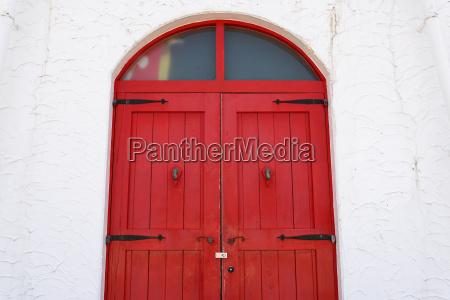 old wooden red door with metal