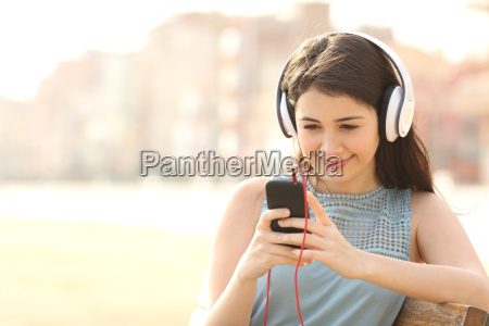 girl listening music with headphones from