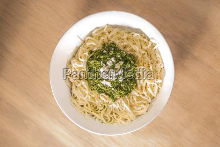 fresh tagliatelle with pesto in bowl