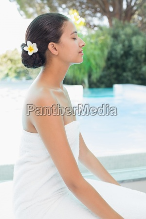 beautiful woman sitting with eyes closed