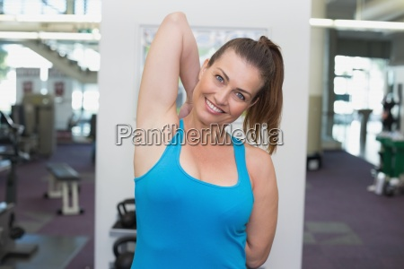 fit brunette warming up in fitness
