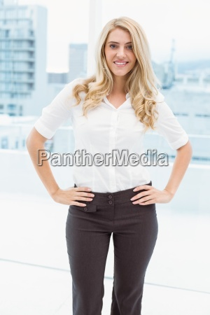 beautiful businesswoman with hands on hips
