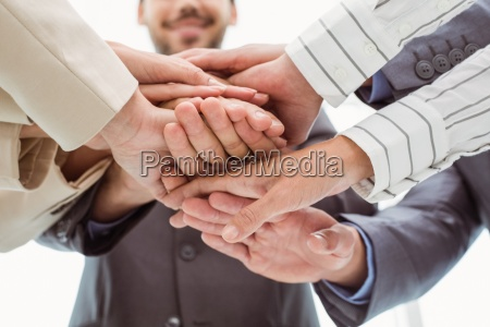 close up of executives holding hands