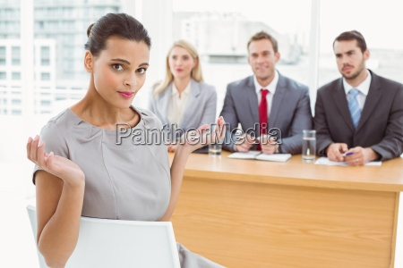 woman sitting in front of corporate