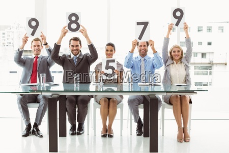 interview panel holding score cards in