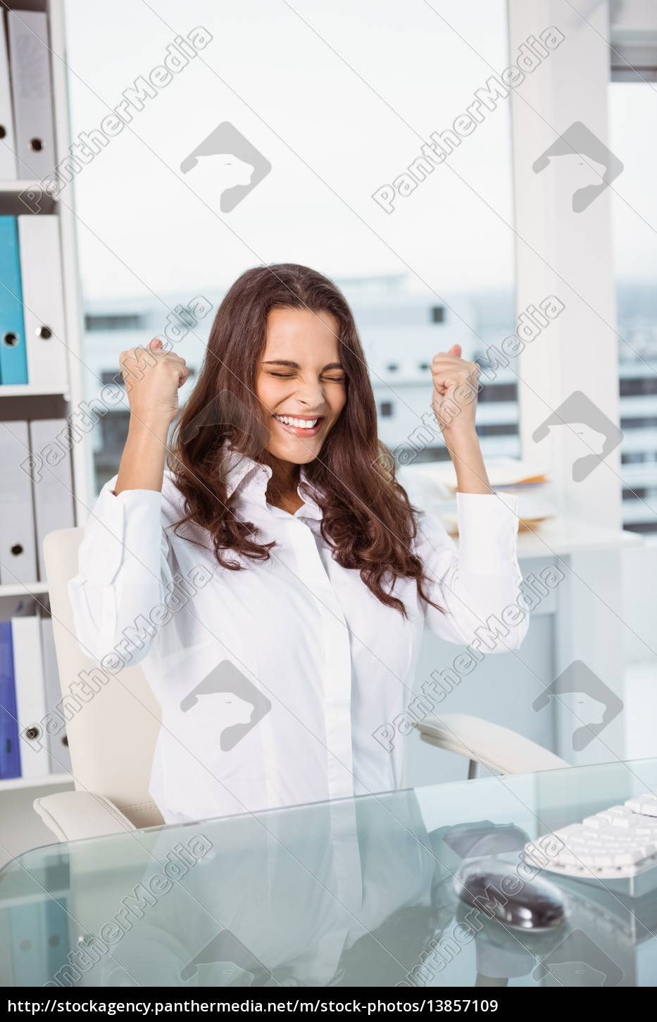 cheerful, businesswoman, cheering, in, office - 13857109