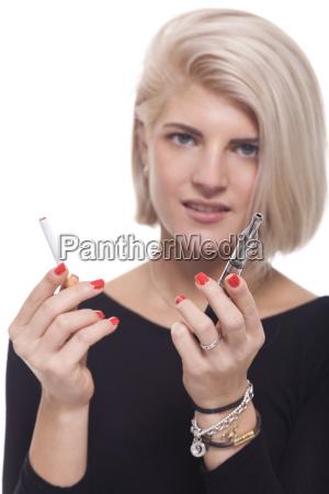 young blonde woman smoking chooses between
