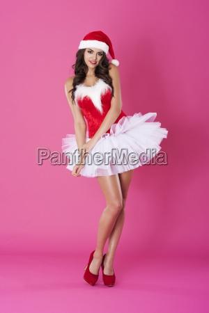 beautiful woman wearing sexy santa claus