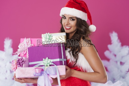 beautiful santa claus with christmas presents