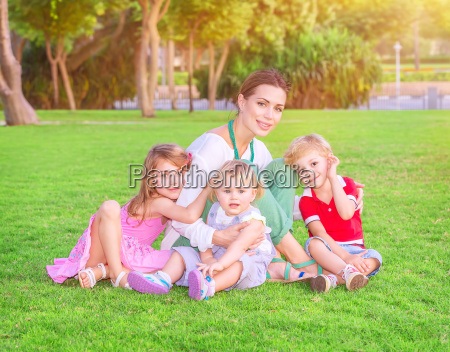 happy mother with babies