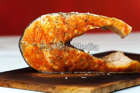 grilled salmon steak on wood