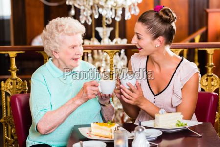 grandmother and granddaughter at cafe in
