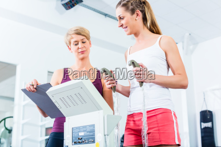 trainer with body fat scale in