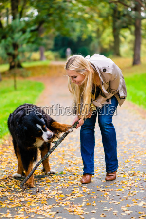 woman and dog in retrieving of