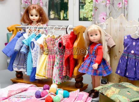 two dolls with their clothes